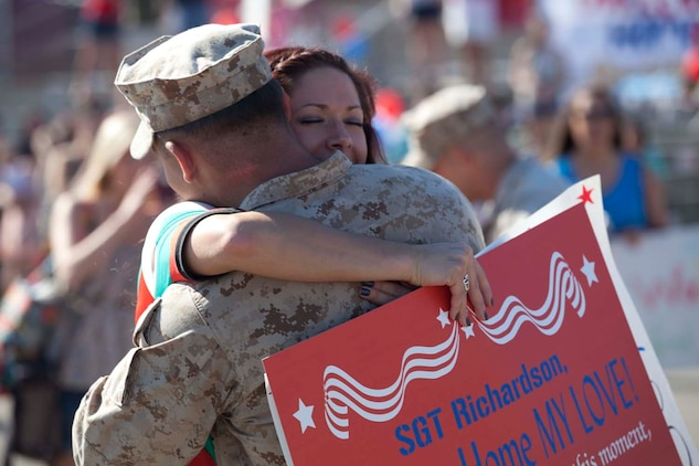 Sergeant Nick Richardson, an Infantryman serving with Weapons Company, 3rd Battalion, 5th Marine Regiment and a native of Broken Arrow, Okla., hugs his wife, Lana, after being dismissed from a formation on the San Mateo parade deck here, May 13, 2013. Families and friends watched their Marines and sailors march onto the parade deck after an eight-month deployment with the 15th Marine Expeditionary Unit. The MEU deployed Sept 17, 2012, and traveled to Dubai, Jordan, Oman, China, and Hawaii.
