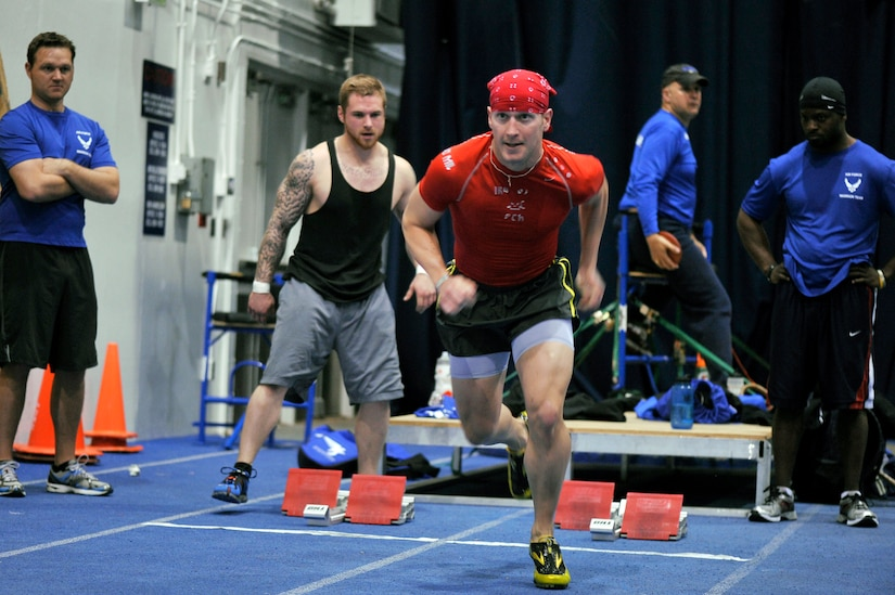 Capt. Mitchell Kieffer sprints at the Academy indoor track during the Wounded Warrior Games Training Camp held in Colorado Springs, Colo., April 17, 2013. (U.S. Air Force photo/Desiree N. Palacios)