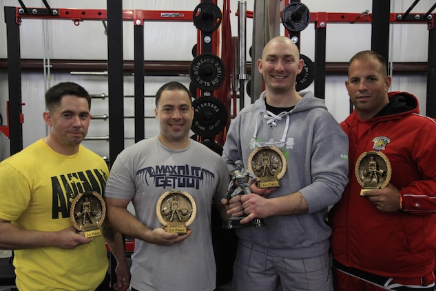 (From left to right) Staff Sgt Diego Corr (of the 2nd Marine Division), Sgt Thomas Geist, Staff Sgt Erik Hodge and Cpl Michael Politowicz display their trophies after competing in the Spring military challenge in Newport, N.C. March 28. MARSOC's Stone Bay Bar Benders competed in the powerlifting contest to help raise money for the Hope for the Warriors foundation, a charity that helps wounded warriors and their families. (U.S. Marine Corps photo by Sgt Kyle McNally/Released)