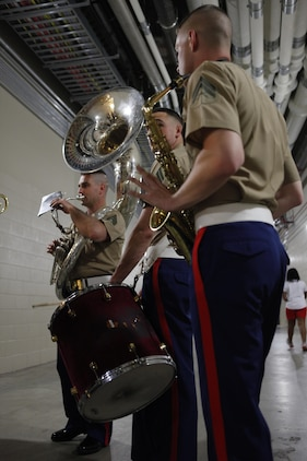 Members of the Marine Corps Base Quantico, Va., Marine Corps Band practice during the weather delay at U.S. Marine Day at Nationals Park in Washington May 8. A group of band members played a selection of upbeat jazzy tunes for the crowds before the game.