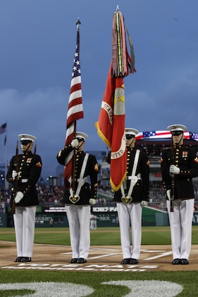 The Marine Corps Color Guard presented and posted the colors during the U.S. Marine Day at Nationals Park in Washington May 8. The four Marine Corps infantrymen travel around the nation bearing the official battle colors of the Marines Corps.