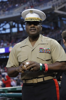 Lt. Gen. Willie Williams, director of Marine Corps staff at Headquarters Marine Corps, throws the ceremonial first pitch during the U.S. Marine Day at Nationals Park in Washington May 8. Williams threw a high arching pitch to Chad Tracy, the Washington Nationals third baseman. Williams will retire this summer after 40 years of service.
