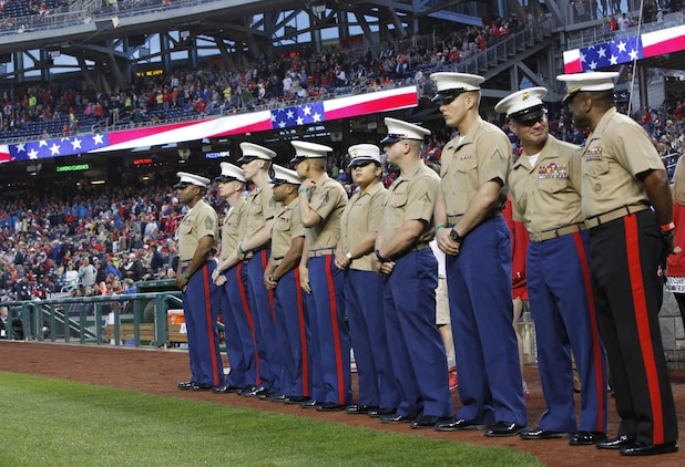 Marines stand on the field for the pre-game ceremony during the U.S. Marine Day at Nationals Park in Washington May 8. Active duty and retired Marines were present for the event.