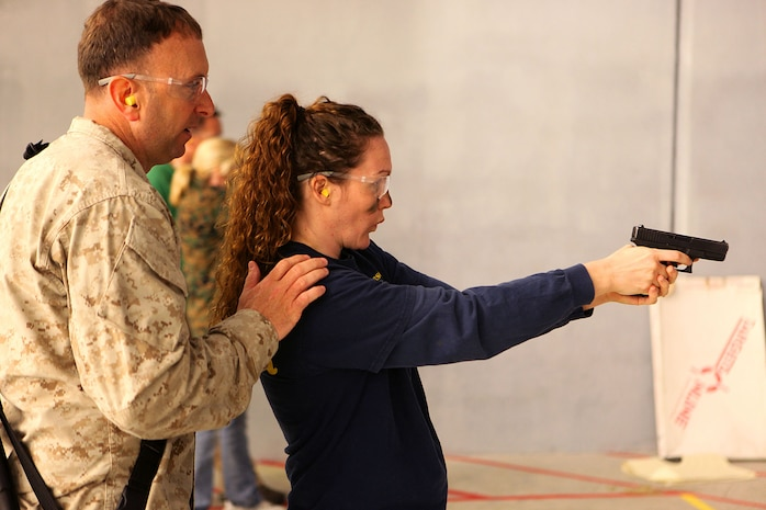 Marine spouses and children participate in a family day sponsored by U.S. Marine Corps Forces, Special Operations Command, April 26, 2013. The spouses shot live weapons, rappelled and were taught martial arts by Marine instructors. Children played games and did modified exercises during the event. Static displays showed MARSOC weapons and gear. After all the events the Marines and families had a barbecue.