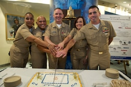 Master Chief Petty Officer of the Navy (MCPON) Michael D. Stevens, center, and the four 2012 Sailors of the Year cut a cake after the 2012 Sailor of the Year pinning ceremony. The Sailors of the Year were meritoriously promoted to chief petty officer by Vice Chief of Naval Operations Adm. Mark E. Ferguson.