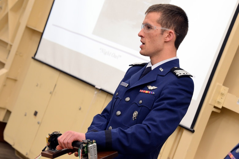 "Cadet 1st Class Zachary Adams controls the ""Night Owl,"" a cyclogyro capable of omnidirectional thrust, during a demonstration to Air Force Academy senior leaders and Boeing representatives May 13, 2013. Adams was the chief engineer for the project, which included eight other cadets. (U.S. Air Force photo/Mike Kaplan)"