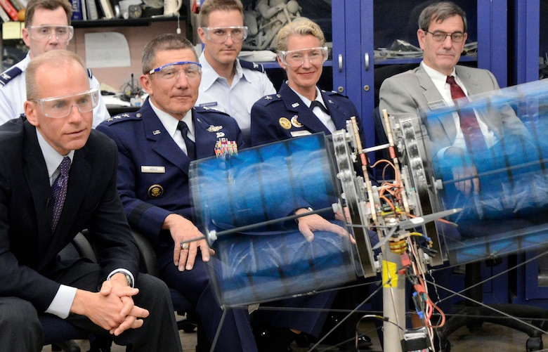 "Dennis Muilenburg, Air Force Academy Superintendent Lt. Gen. Mike Gould, Dean of the Faculty Brig. Gen. Dana Born and others watch a demonstration of a cadet aeronautical engineering project called the ""Night Owl"" in the Aeronautics Laboratory May 13, 2013. A team of nine cadets designed the cyclogyro, which is designed to direct thrust in any direction. Muilenburg is the president and CEO of Boeing Defense, Space and Security. (U.S. Air Force photo/Mike Kaplan)"