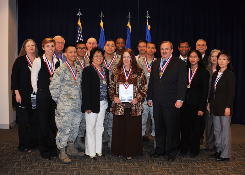 The Military Satellite Communications Engineering Division is recognized by the Federal Executive Board with a Partnership Award, May 8. The division was cited for its partnerships in providing communications for approximately 16,000 aircraft, ships, mobile and fixed sites. (Photo by Sarah Corrice)