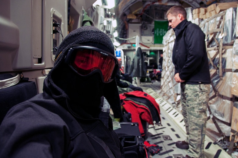 Staff Sgts. Robert Tingle (left) and Erik Welp, 62nd Aircraft Maintenance Squadron flying crew chiefs, along with the aircrew begin to don cold weather gear May 10, 2013 in preparation for a decent into Pegasus Field at McMurdo Station, Antarctica. The temperatures at Antarctica were at approximately minus 40 degrees Fahrenheit. (U.S. Air Force photo/Staff Sgt. Robert Tingle)