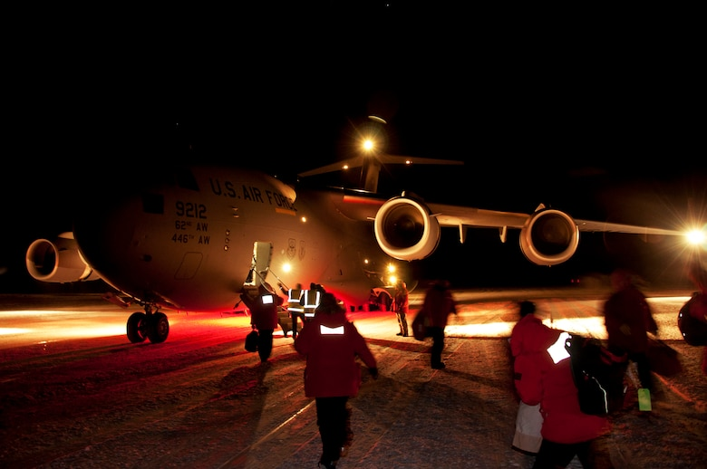 Passengers board a C-17 Globemaster III May 10, 2013 at McMurdo Station, Antarctica. Airmen from Joint Base Lewis-McChord, Wash., arrived to pick up an ailing contractor working at McMurdo and transported the patient to Christchurch, New Zealand, for further medical attention. (U.S. Air Force photo/Staff Sgt. Robert Tingle)