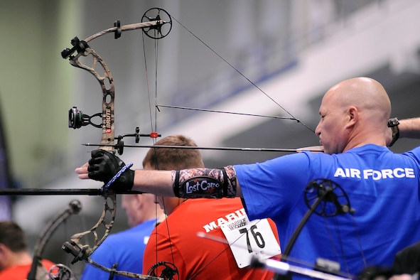 Retired Tech. Sgt. Corey Carter lines up a shot with a compound bow during the Warrior Games archery competition at the Air Force Academy May 15, 2013. Carter, previously an Air National Guardsman assigned to Rickenbacker Air National Guard Base, Ohio, was injured by a roadside bomb in Balad, Iraq, in September 2004. He placed fourth in the compound open. (U.S. Air Force photo/Sarah Chambers)