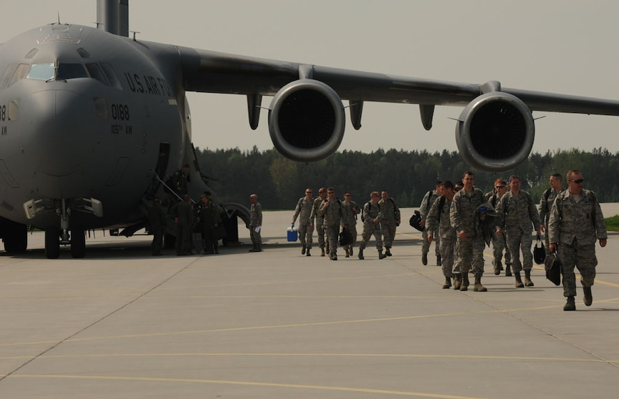 LASK AIR BASE, Poland - Members of the 115th Fighter Wing, Wisconsin Air National Guard, arrive at Lask Air Base, Poland, for Aviation Detachment Rotation 13-2, May 9, 2013. More than 100 Airmen will be working with the Polish Air Force for the first F-16 fighter aircraft rotation and second overall this year. The first rotation took place at Powidz Air Base with the C-130J Super Hercules from the 37th Airlift Squadron, Ramstein Air Base, Germany.(U.S. Air Force photo by Tech. Sgt. Kenya Shiloh/released)