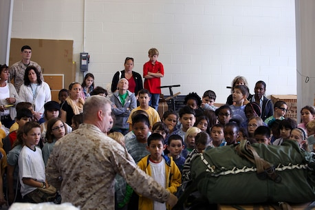 """Approximately five classes totaling 120 students from the 4th Grade class from Bitz Intermediate School visited the U.S. Marine Corps Forces, Special Operations Command Paraloft. """"It's good for them, we put things into perspective for the kids and they learn how parachutes work,"""" said Sgt. Patrick Ward, 27, Marine Special Operations Regiment, parachute rigger, from Rockford, Mich. The Marines displayed the numerous types of equipment and the different parachutes they use."""
