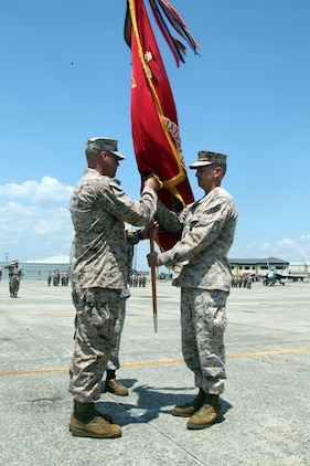 Lt. Col. Bill Gray (right), the outgoing commanding officer of Marine Aviation Logistics Squadron 31, passes the colors to Lt. Col. William Stansell (left), the incoming commanding officer of MALS-31, during the change of command ceremony aboard Marine Corps Air Station Beaufort, May 10. The passing of the colors symbolizes the passing of command from one commanding officer to another.