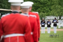 Marine Barracks Washington Marines hold flags to be presented to family members and friends of the Marines, sailors and airman that died in a CH-53 crash during The Battle of Koh Tang, here, May 15, 2013. The service members remains were lost to the Gulf of Thailand after attempting to land on the Koh Tang island when the helicopter was taken down by enemy fire, resulting in the loss of half of its occupants.