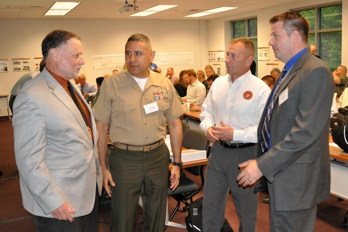 From left, Daniel Dunmire, director of the Department of Defense Corrosion Office; Master Gunnery Sgt. Antonio Zambrano, maintenance management chief with Installations and Logistics; Bernard Friend, Corrosion Prevention and Control program operations and sustainment; and Matthew Koch, CPAC program manager, talk May 7 prior to the start of the CPAC Working Group.