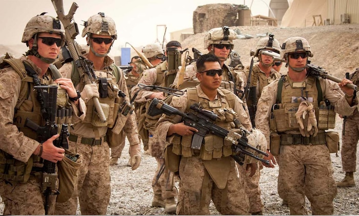 U.S. Marines and Sailors with Weapons Company, 2nd Battalion 9th Marines, Regimental Combat Team 7, wait out a dust storm on Camp Bastion, Helmand province, Afghanistan, April 15, 2013.