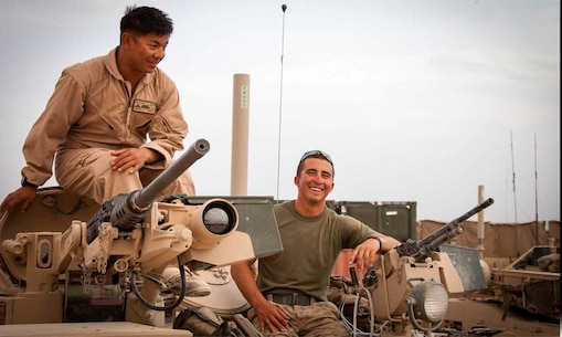 U.S. Marine Corps Lance Cpl. Phillip Lim, left, and Cpl. Brandon Baber, both assigned to Delta Company, 1st Tank Battalion, Regimental Combat Team 7, take a pause from conducting function checks on an M1A1 Abrams tank on forward operating base Shir Ghazay, Helmand province, Afghanistan, April 25, 2013.
