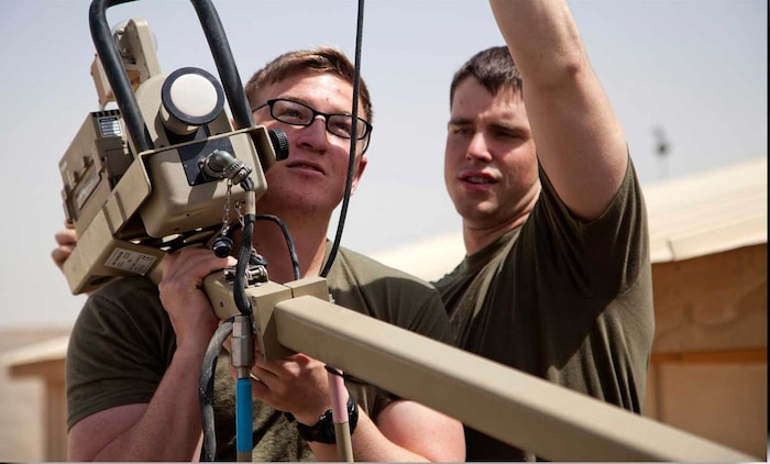 U.S. Marine Corps Lance Cpl. Zachary Schaible, left, and Cpl. Andrew Sanders, assigned to Headquarters Company, Regimental Combat Team 7, set up Secure Internet Protocol and Non-secure Internet Protocol Router Access Point (SNAP) satellite communications system on Camp Leatherneck, Helmand province, Afghanistan, April 24, 2013.