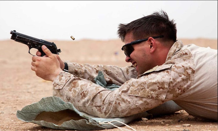 U.S. Marine Corps Cpl. Jared Bailey, from Higden, Ark., assigned to Afghan National Civil Order Police Kandak 1 Advisor Team, Regimental Combat Team 7, conducts small arms live fire training on Camp Leatherneck, Helmand province, Afghanistan, April 25, 2013.