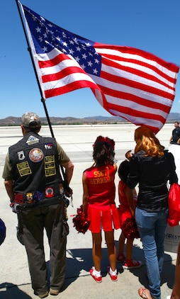 """Precious Baltazar, 9 years old, waits for her father to return during a homecoming ceremony aboard Marine Corps Air Station Camp Pendleton, Calif., May 13. Her father returned with the rest of the Marine Medium Helicopter Squadron 364 """"Purple Foxes"""" after an eight-month deployment with the 15th Marine Expeditionary Unit."""