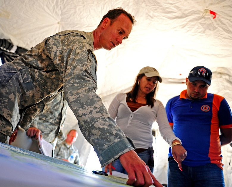 United States Army Chief Warrant Officer Edmond Bessette, CENTAM Survey and Assessment Team member and Iris Medina, C-SAT member identify the location of damage for a simulated hurricane with a Honduran Comision Permanente de Contingencias member, during a simulated Hurricane disaster response exercise at Puerto Castilla, Honduras, May 15. The C-SAT team responds to a natural disaster and humanitarian assistance notification in the Central America Region to conduct an assessment of the area before military forces are deployed.(Air Force photo by Staff Sgt. Eric Donner)