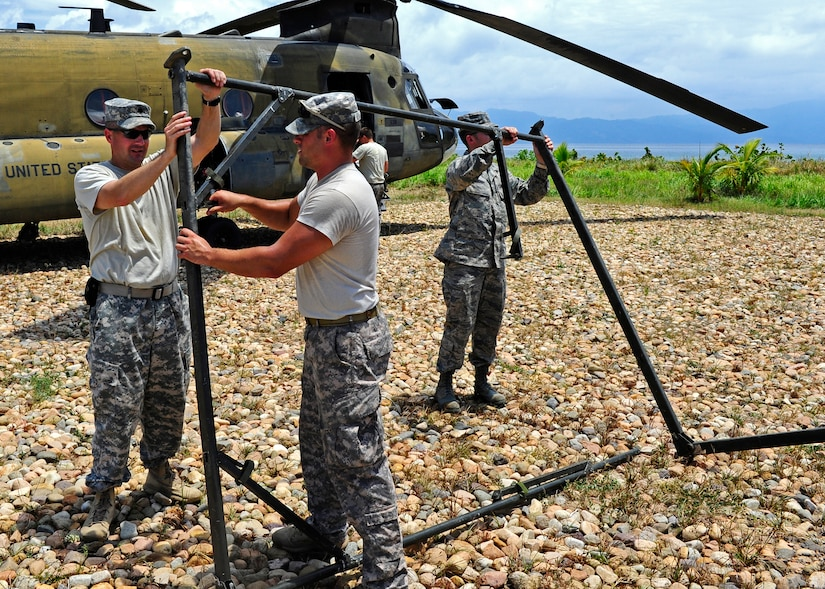 United States Army Lt. Col. Jay Liddick, CENTAM Survey and Assessment Team leader, U.S. Army 1st Lt. Chad Wallway, C-SAT member and U.S. Air Force Capt. Scott Gaught, C-SAT member, set up a tent after arriving in Puerto Castilla, Honduras, for a simulated hurricane disaster response exercise, May 15. The C-SAT team responds to a natural disaster and humanitarian assistance notification in the Central America Region to conduct an assessment of the area before military forces are deployed.(Air Force photo by Staff Sgt. Eric Donner)
