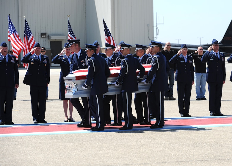 Beale's Honor Guard carries the remains of Staff Sgt. Richard Dickson, of Rancho Cordova, Calif., during a dignified transfer at Beale Air Force Base Calif., May 10, 2013. Dickson was assigned to the 306th Intelligence Squadron at Beale. (U.S. Air Force photo by John Schwab/Released)