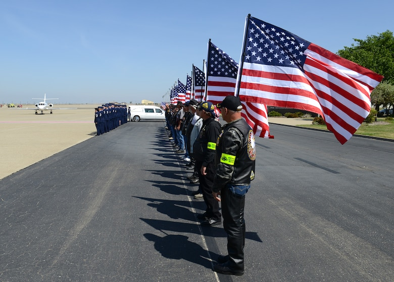 Members of the Patriot Guard Riders honor a fallen Airman during a dignified transfer at Beale Air Force Base, Calif., May 10, 2013. Staff Sgt. Richard Dickson was killed in a MC-12 Liberty aircraft crash in Afghanistan, April 27. (U.S. Air Force photo by John Schwab/Released)