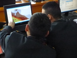 Representatives from the Mongolian Armed Forces explore interpolated raster surfaces at the Advanced GIS Workshop.
