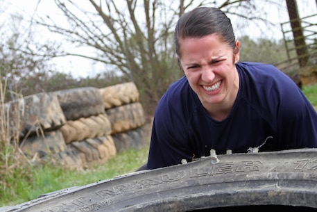 Paige C. Colburn, a poolee with Recruiting Substation Monroe, Recruiting Station Columbia, flips a large tire during an April 3 physical training session in Monroe, N.C. Paige, who joined the Marine Corps Delayed Entry Program on Jan. 22, is scheduled to ship to recruit training on April 8. (Photo by Sgt. Aaron Rooks)