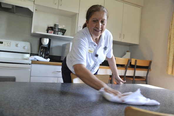 Mary Miller, 509th Force Support Squadron house keeper, wipes down a table at the Whiteman Inn on Whiteman Air Force Base, Mo., May 7, 2013. After each guest leaves, housekeepers must perform turnovers, which is the process of cleaning and replacing used toiletries, linens and furniture. (U.S. Air Force photo by Airman 1st Class Keenan Berry/Released)