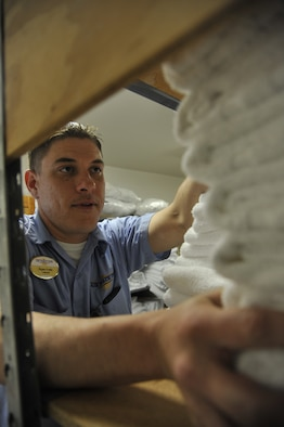 Ryan Foltzs, 509th Force Support Squadron maintenance crew member, restocks towels and linen at the Whiteman Inn on Whiteman Air Force Base, Mo., May 7, 2013. When all used linen is collected from the hotel, the maintenance crew will count and give them to the contractors to clean. Once the linen is cleaned, the maintenance crew will receive them to do linen exchange. (U.S. Air Force photo by Airman 1st Class Keenan Berry/Released)