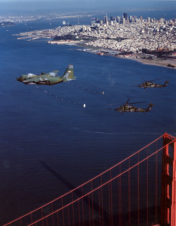 Aircrafts from the 129th Rescue Wing fly in formation over San Francisco, California, circa 2000.  The mission of the 129th is to train and be prepared to perform its wartime mission of combat search and rescue anywhere in the world. Its personnel and aircraft locate and recover aircrew and non-aircrew personnel from both enemy-held and friendly territory and seas. In addition, the 129th provides manpower, materiel and equipment to conduct peacetime search and rescue operations in the Pacific Ocean and off the coast of California.  (U.S. Air Force photo by Master Sgt. Rich Loomis)