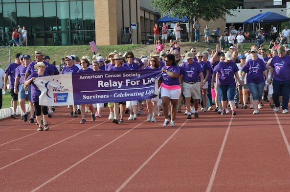 SAN ANGELO, Texas – Cancer survivors walk the first lap at the Relay for Life event at Angelo State University track and field May 17. The relay raised more than $238,000 to help fight cancer. (U.S. Air Force photo/ Airman 1st Class Joshua Edwards)