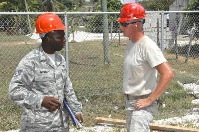 Staff Sgt. Tori Wynn, left, unit safety representative for the 823rd Expeditionary RED HORSE Squadron, talks with Tech. Sgt. Luke McGlone, pavement and equipment supervisor assigned to the 823rd RED HORSE Squadron, at the Trial Farm Government School construction site, May 18, 2013. Wynn was conducting a weekly safety inspection at the site to assist with adherence to safety standards. Civil Engineers from both the U.S. and Belize are constructing various structures at schools throughout Belize as part of an exercise called New Horizons. Building these facilities will support further education for the children of the country and provide valuable training for U.S. and Belizean service members. (U.S. Air Force photo/Master Sgt. James Law)