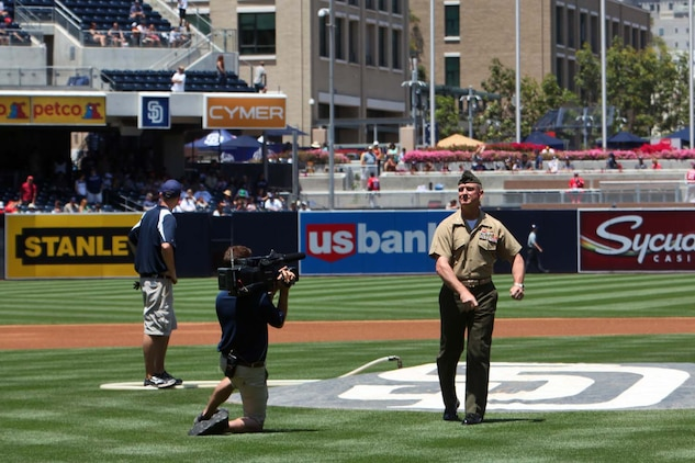 Colonel Scott D. Campbell, commanding officer, 15th Marine Expeditionary Unit, throws the opening pitch during the Padres' Military Appreciation Day at PETCO Park in San Diego, May 19. The 15th MEU was invited to the game to celebrate their return from an eight-month deployment. During the event, Marines from each supporting element of the MEU stepped onto the field in front of thousands as the 15th MEU Command Element, Battalion Landing Team 3/5, Combat Logistics Battalion 15 and Marine Medium Helicopter Squadron 364 (Rein.) were recognized. (U.S. Marine Corps photo by Cpl. Timothy Childers/Released)