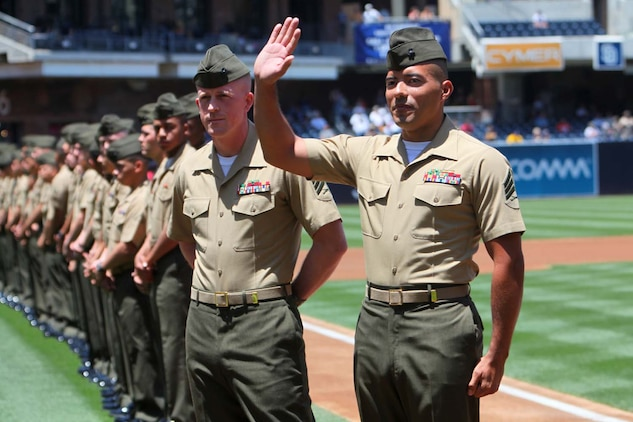 Sergeant Thomas G. Ochoa, motor transportation maintenance chief, Command Element, 15th Marine Expeditionary Unit, waves to the stadium during the Padres' Military Appreciation Day at PETCO Park in San Diego, May 19. Marines with the 15th MEU were invited to the game to celebrate their return from an eight-month deployment. During the event, Marines from each supporting element of the MEU stepped onto the field in front of thousands as the 15th MEU Command Element, Battalion Landing Team 3/5, Combat Logistics Battalion 15 and Marine Medium Helicopter Squadron 364 (Rein.) were recognized. Ochoa, 29, is from Los Angeles (U.S. Marine Corps photo by Cpl. Timothy Childers/Released)