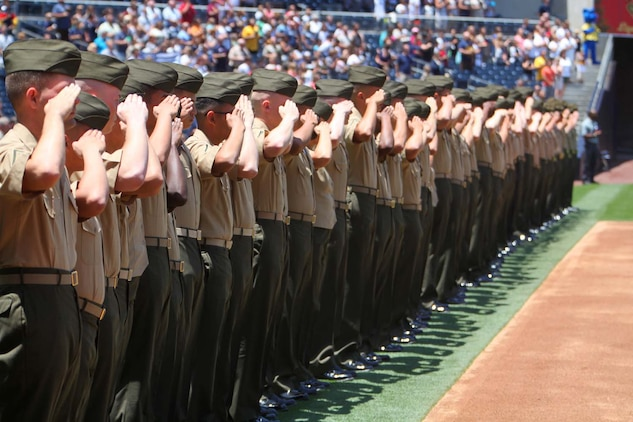 Marines with the 15th Marine Expeditionary Unit salute during the playing of the national anthem at the Padres' Military Appreciation Day at PETCO Park in San Diego, May 19. The 15th MEU was invited to the game to celebrate their return from an eight-month deployment. During the event, Marines from each supporting element of the MEU stepped onto the field in front of thousands as the 15th MEU Command Element, Battalion Landing Team 3/5, Combat Logistics Battalion 15 and Marine Medium Helicopter Squadron 364 (Rein.) were recognized. (U.S. Marine Corps photo by Cpl. Timothy Childers/Released)