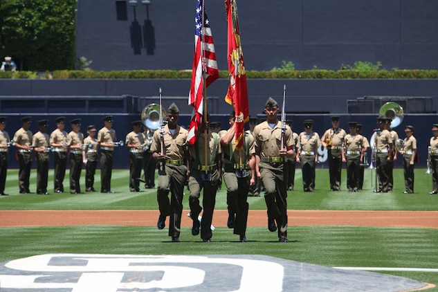 The 15th Marine Expeditionary Unit color guard march on the PETCO Park field during the Padres' Military Appreciation Day at PETCO Park in San Diego, May 19. Marines with the 15th MEU were invited to the game to celebrate their return from an eight-month deployment. During the event, Marines from each supporting element of the MEU stepped onto the field in front of thousands as the 15th MEU Command Element, Battalion Landing Team 3/5, Combat Logistics Battalion 15 and Marine Medium Helicopter Squadron 364 (Rein.) were recognized. (U.S. Marine Corps photo by Cpl. Timothy Childers/Released)