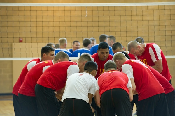 LCpl Seanoa Fuifatu (USMC #11 Camp LeJeune, NC) totally focused in the team's huddle against the Air Force on day one.