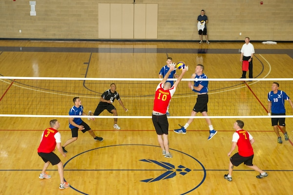 All Tourney selectee Sgt Clay Dooley (USMC #10 Camp Pendleton, CA) blocks a USAF spike