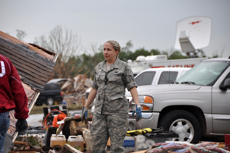 Airman 1st Class Tracy Barnhill, 137th Maintenance Group surveys the damage of her mother's house after devastating tornado hit the homes of those living in Moore, Okla., May 20, 2013. (U.S. Air Force photo by Senior Airman Mark Hybers)