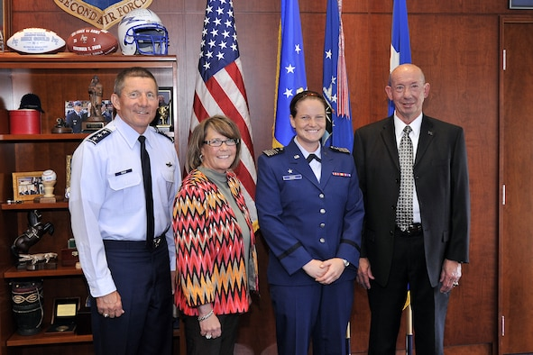 Cadet 1st Class Hannah Dake was named the recipient of the ITA National Arthur Ashe Leadership and Sportsmanship award for the 2012-13 academic year, May 21. (From left to right): Lt. Gen. Mike Gould, Kim Gidley, Cadet 1st Class Hannah Dake, and Dr. Hans Mueh. (U.S. Air Force photo/Raymond McCoy)