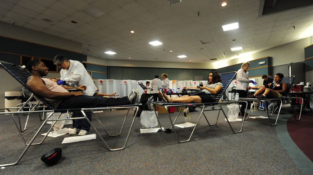 Volunteers donate pints of blood during an American Red Cross blood drive at Whiteman Air Force Base, Mo., May 16, 2013. With a mission to provide life-saving blood to patients in times of crises and disasters, the American Red Cross is the largest supplier of blood in the U.S. (U.S. Air Force photo by Staff Sgt. Nick Wilson/Released)