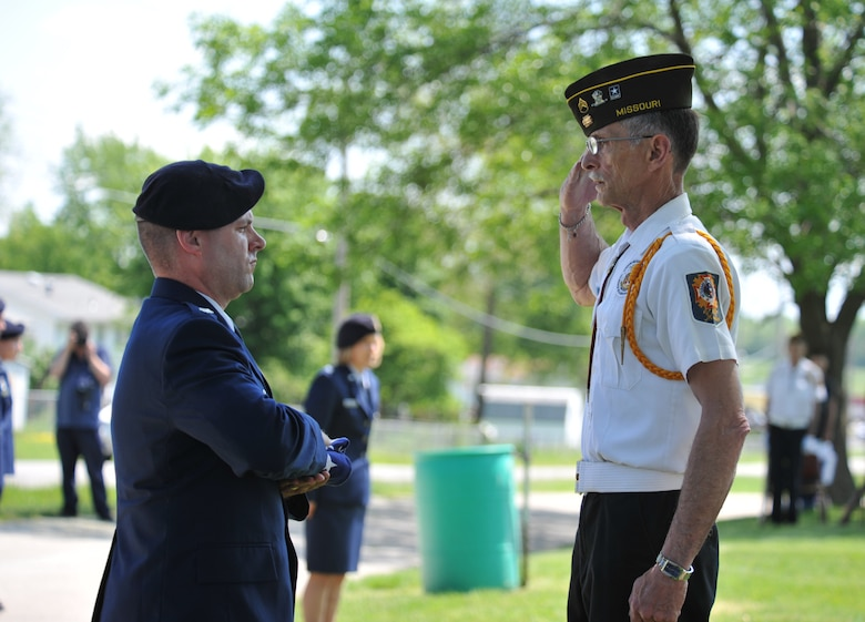 Joe Cochran, president of the local Veterans of Foreign Wars, salutes the flag held by Lt. Col. Christopher Neiman, 509th Security Forces Squadron commander, during a wreath-laying ceremony for 2nd Lt. George Whiteman May 18, 2013, in Sedalia, Mo. Whiteman, who was born in Sedalia in 1919, died during the attack on Pearl Harbor on Dec. 7, 1941. (U.S. Air Force photo by Senior Airman Brigitte N. Brantley/Released)
