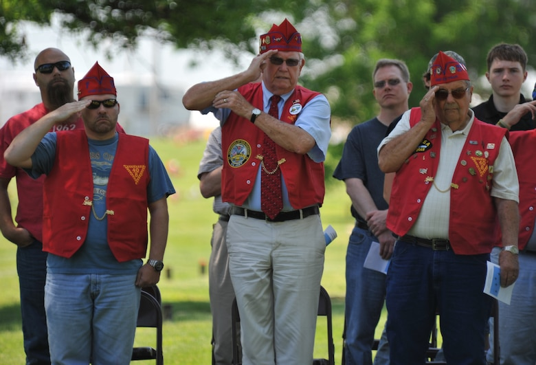 Members from the local Veterans of Foreign Wars chapter salute while the flag is raised during a wreath-laying ceremony for 2nd Lt. George Whiteman May 18, 2013, in Sedalia, Mo. Whiteman, a Sedalia native, was one of the first Airmen to die during World War II when the Japanese attacked Pearl Harbor.  (U.S. Air Force photo by Senior Airman Brigitte N. Brantley/Released)