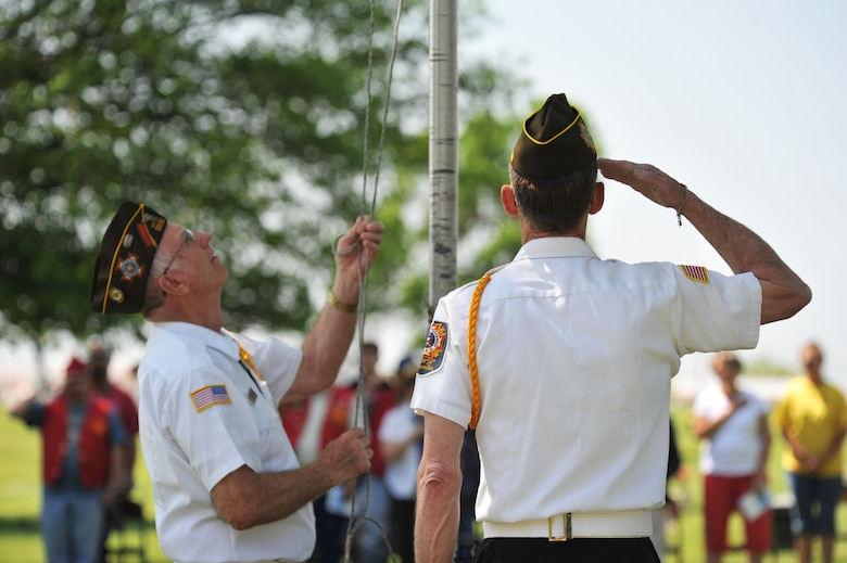 Von Holton, left, and Joe Cochran, local Veterans of Foreign Wars members, lower the flag during the 25th annual wreath-laying ceremony for 2nd Lt. George Whiteman May 18, 2013, in Sedalia, Mo. Both Holton and Cochran have attended many of the ceremonies honoring Whiteman, a pilot who was one of the first Airmen to die during World War II. (U.S. Air Force photo by Senior Airman Brigitte N. Brantley/Released)
