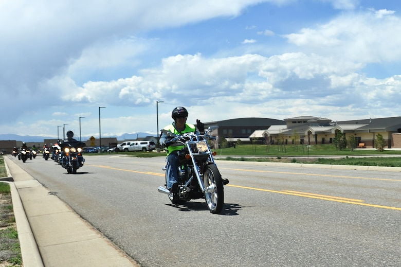 Col. Dan Dant, 460th Space Wing commander, drives his motorcycle May 16, 2013, Buckley Air Force Base, Colo.  More than 40 Team Buckley members participated in the farewell motorcycle ride hosted for Dant. The farewell ride started with a required pre-season motorcycle safety brief presented by the 460th Space Wing Safety Office and a burger burn by the Air Force Sergeants Association.  (U.S. Air Force photo by Airman 1st Class Riley Johnson/Released)
