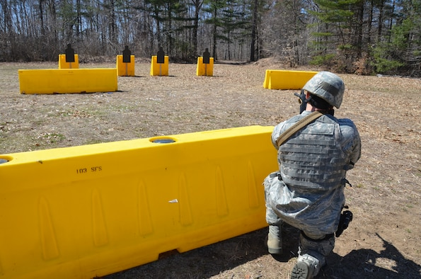 An Airman with the 103rd Security Forces Squadron takes aim on a target downrange during a shoot, move and communicate training session at Bradley Air National Guard Base, East Granby, Conn., April 6, 2013. (Air National Guard photo by 1st Lt. Dawn Surprenant/Released)